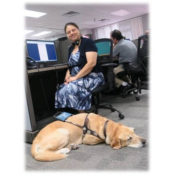 Katie and her guide dog, Charlie, pre-pandemic in a call center